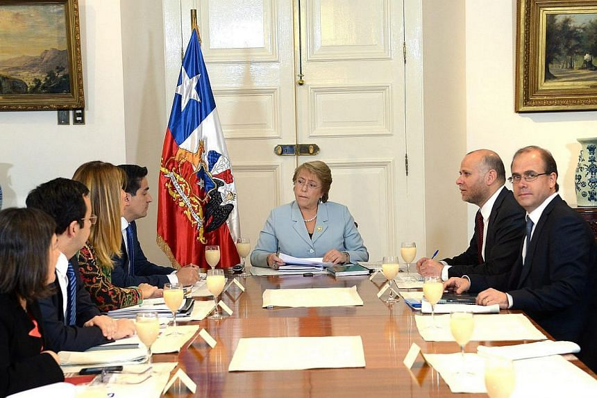 Chilean President Michelle Bachelet (centre) meeting with members of the Committee of Politics at La Moneda Palace in Santiago de Chile, on May 6, 2015. Ms Bachelet announced a surprise Cabinet reshuffle on Wednesday, in a second-term scramble to sil