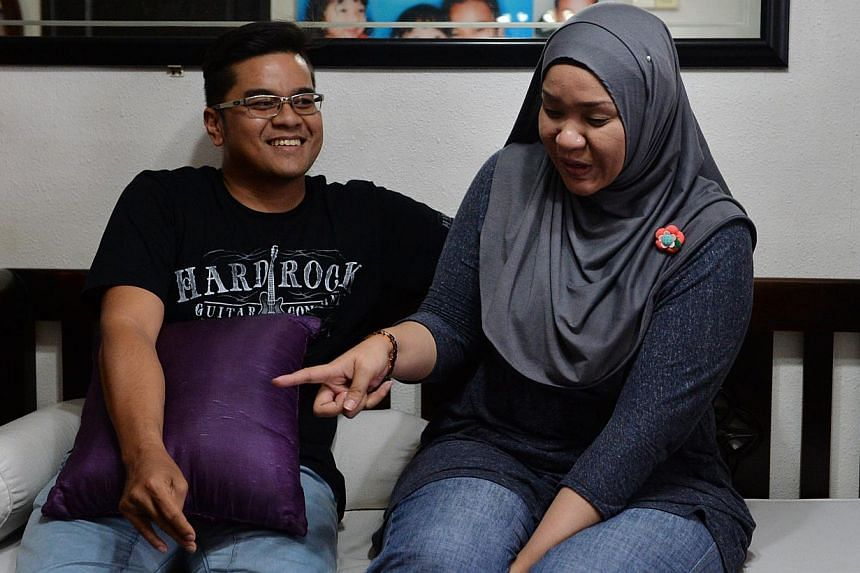 Madam Nur'Ashkin Zainol with her husband, Fazlan Sahat. Their neighbour at Block 19 Eunos Crescent, Madam Soh Siew Zhen, is a hoarder. Madam Nur'Ashikin posted a video showing hundreds of cockroaches swarming out to the common corridor after the