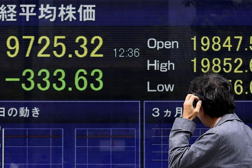 Asian stocks and bonds retreated, extending a global rout, as Japan returned from a three-day holiday. -- PHOTO: REUTERS