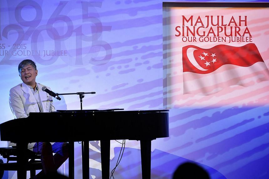 Singer-songwriter Dick Lee (above) singing the song, Our Singapore, which he wrote as this year's National Day theme song. -- ST PHOTO: KUA CHEE SIONG