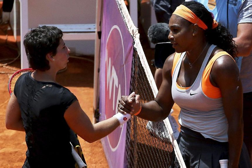 Serena Williams (right) of the USA is congratulated by Spain's Carla Suarez Navarro (left) after winning their quarter final match of the Mutua Madrid Open tennis tournament on May 7, 2015. -- PHOTO: EPA