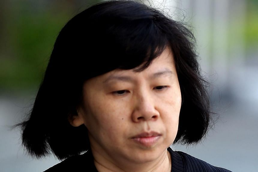 Amos Yee's mother, Mary Toh arriving at the State Court for Amos Yee's trial on May 7, 2015. -- ST PHOTO: WONG KWAI CHOW