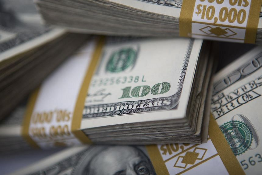 "The US dollar fell sharply Wednesday after weaker-than-expected US economic data and a warning from Federal Reserve Chair Janet Yellen that stock valuations were ""quite high"". -- PHOTO: BLOOMBERG"