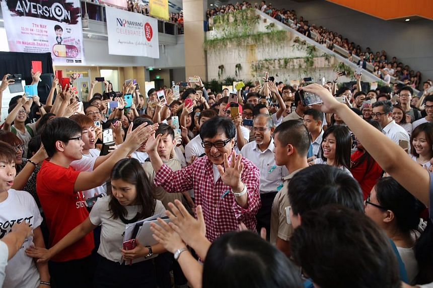 Action superstar Jackie Chan is Singapore's new anti-drug ambassador and hopes to influence youth to say no to drugs. The 61-year-old was at the launch of a new anti-drug mobile game application at Nanyang Polytechnic on Thursday. -- ST PHOTO: ONG WE