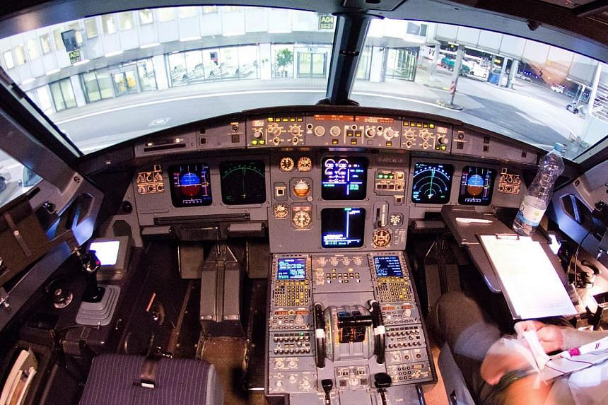 A file picture dated March 22, 2015 of the cockpit's interior of the crashed Germanwings A320 aircraft at the airport in Duesseldorf, Germany. The European Commission announced it had set up a special task force to review cockpit safety rules after t