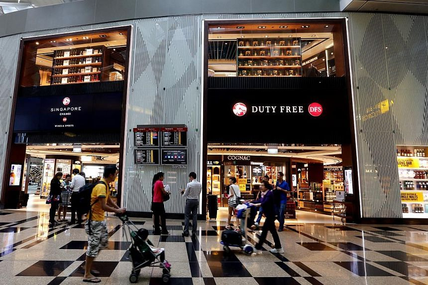 DFS Group has opened a new 11,400 sq ft double-storey store - its largest so far - as part of plans to improve services and product offerings at Changi Airport's Terminal 3. -- ST PHOTO: CHEW SENG KIM