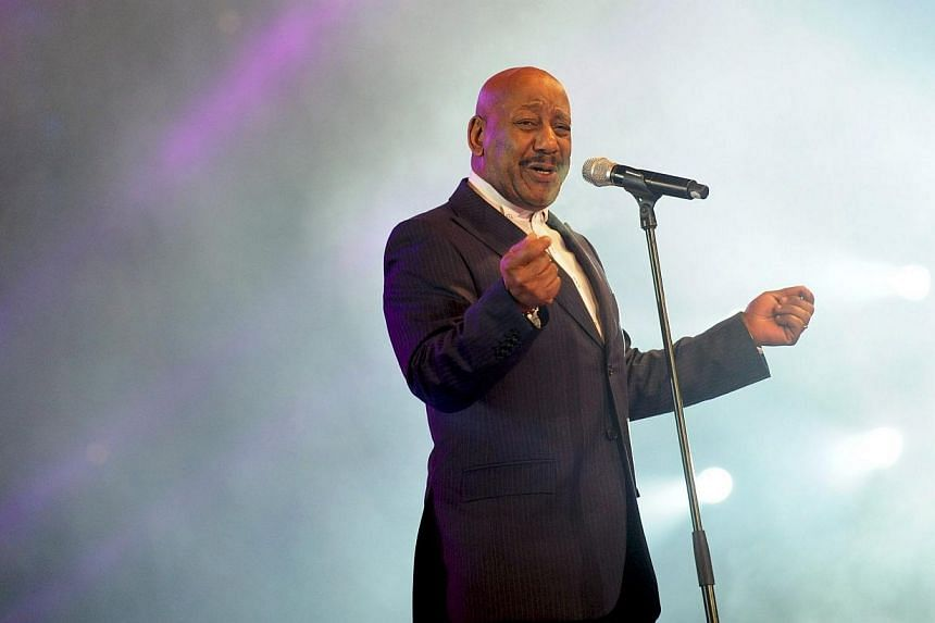 Errol Brown, former singer and founder of the British pop band Hot Chocolate, performs on stage during an Open Air New Year's Eve party at the landmark Brandenburg Gate in Berlin on Dec 31, 2011. -- PHOTO: EPA