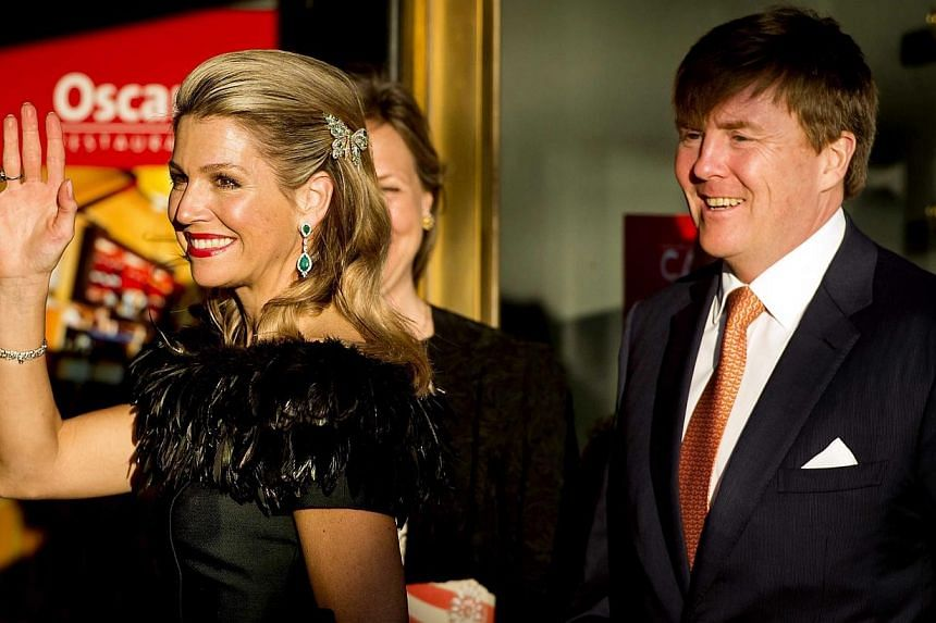 King Willem Alexander of the Netherlands (right) and Queen Maxima arrive for the Dutch 5th of May liberation concert in Amsterdam. -- PHOTO: EPA