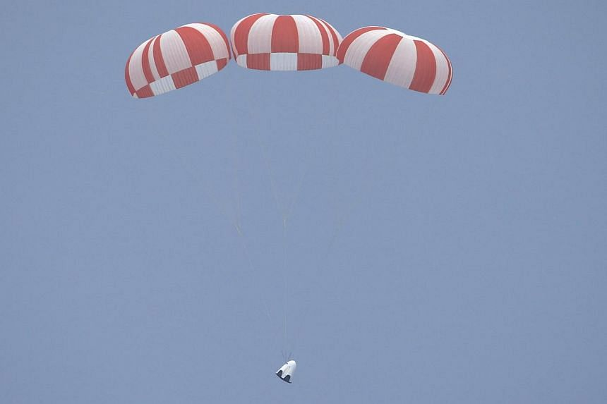The unmanned SpaceX Crew Dragon lands after lifting off from launch pad 40 during a Pad Abort Test at the Cape Canaveral Air Force Station in Cape Canaveral, Florida on Wednesday. -- PHOTO: REUTERS