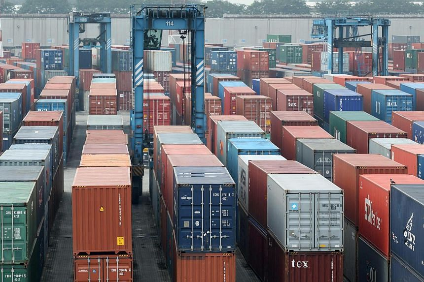 Containers stacked at Port Klang, Selangor, in 2010. Malaysia's March exports rose a surprising 2.3 per cent from a year earlier as demand for electronic products boosted shipments to China and the United States, government data showed on Thursday. -