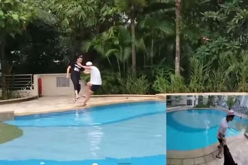 The prankster kicking a man into the swimming pool. -- PHOTO: SCREENGRAB FROM YOUTUBE