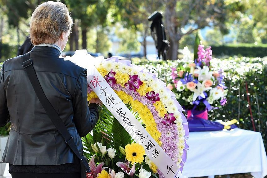 A mourner placing a floral wreath at the funeral service of Andrew Chan in Sydney, Australia, on May 8, 2015. -- PHOTO: EPA