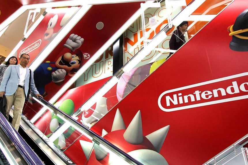 An advertisement of Japanese video game giant Nintendo at an electronic shop in Tokyo on May 7, 2015. -- PHOTO: AFP