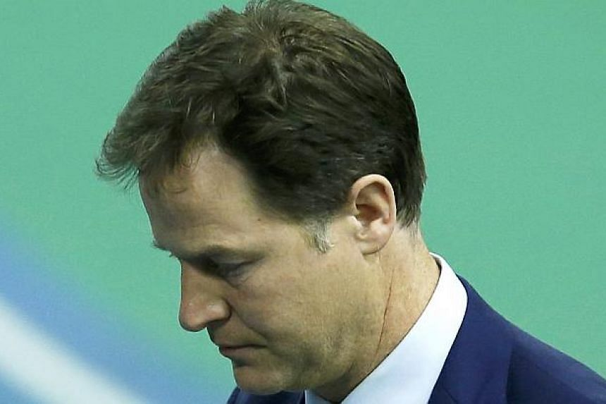 Britain's Liberal Democrat leader Nick Clegg walks off the stage after winning his seat in Sheffield, May 8, 2015.-- PHOTO: REUTERS