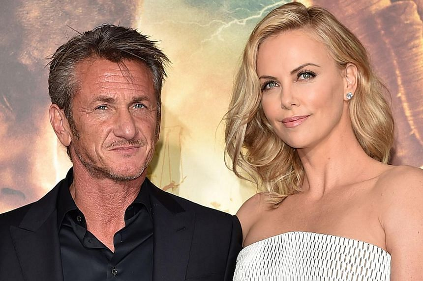 Actors Sean Penn (left) and Charlize Theron (right) at the premiere of Mad Max: Fury Road on May 7, 2015, in Hollywood, California. Theron managed to negotiate an equal salary for The Huntsman after leaked Sony e-mails showed the disparity between pa