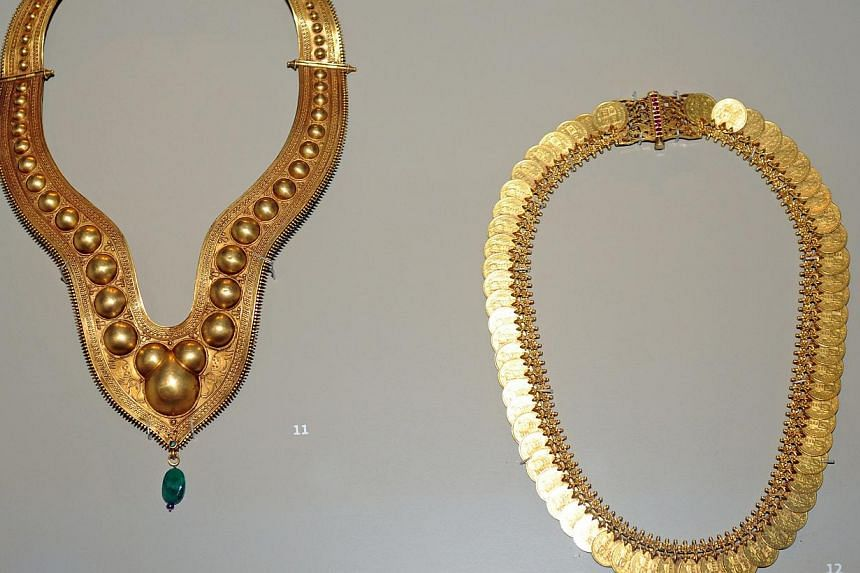 This intricate gold necklace circa early 20th century which originates from Kerala, South India, is on display at the Indian Heritage Centre. -- ST PHOTO: TIFFANY GOH