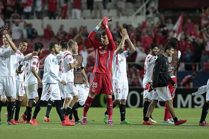 Sevilla players celebrating their victory against Fiorentina at the Ramon Sanchez Pizjuan stadium in Seville, Spain, on May 7, 2015. -- PHOTO: EPA