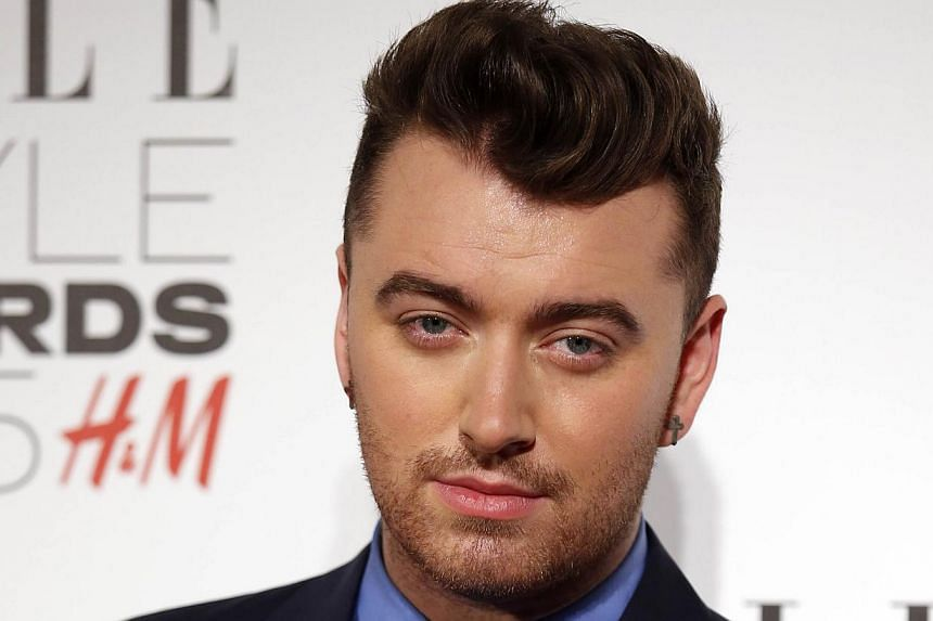 British singer Sam Smith, seen here at the Elle Style Awards 2015 in London, said on Thursday he would undergo surgery on his vocal cords and cancelled weeks of shows. -- PHOTO: AFP