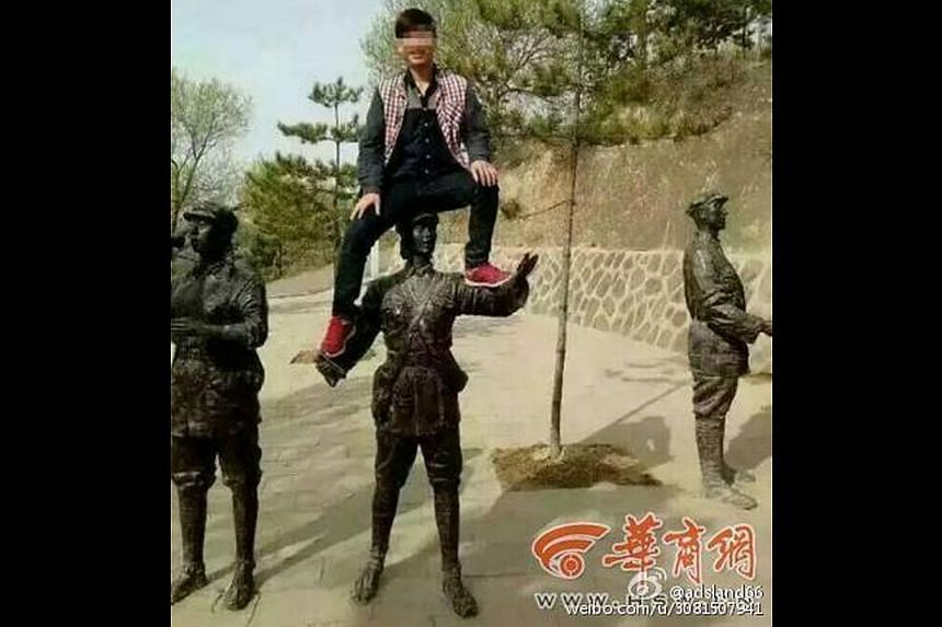 Li Wenchun has been punished for climbing onto a statue depicting a soldier of the Red Army at a commemorative park in China last month.