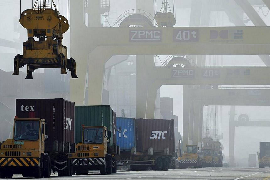 Shipping containers are loaded onto trucks at Dayaowan port in Dalian, Liaoning province, in 2012. China's exports shrank in April, adding downward pressure on an economy grappling with overcapacity and a property slump. -- PHOTO: REUTERS