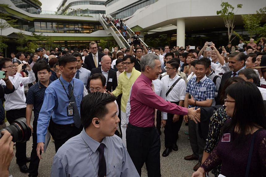 PM Lee Hsien Loong and actor Jackie Chan tour the Singapore University of Technology and Designcampus during its official opening on May 8, 2015.-- ST PHOTO: MARK CHEONG