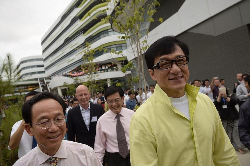 Actor Jackie Chan tours the Singapore University of Technology and Designcampus during its official opening on May 8, 2015.-- ST PHOTO: MARK CHEONG