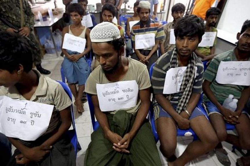 Suspected ethnic Rohingya migrants, who were rescued by Thai officials from a jungle, being detained in Songkhla province. -- PHOTO: THE STAR/ ASIA NEWS NETWORK