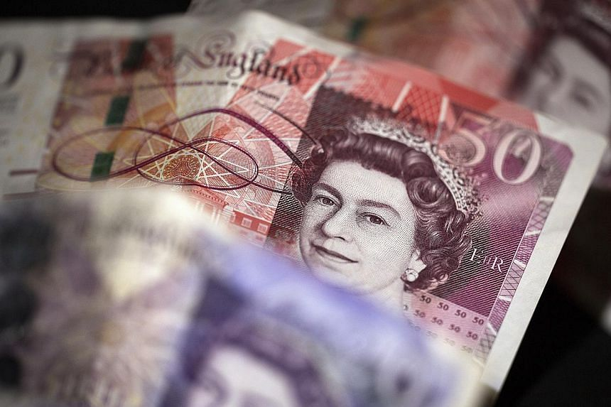 The British pound climbed the most in seven weeks as an exit poll indicated the Conservative Party was on track to lead a minority government after the UK election. -- PHOTO: BLOOMBERG