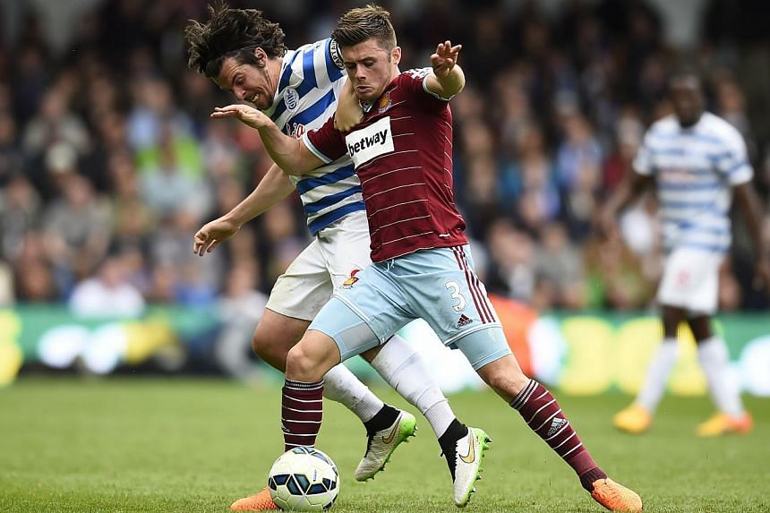 QPR's Joey Barton in action with West Ham's Aaron Cresswell, in their match on April 25, 2015.West Ham United are on course for a place in next season's Europa League after Uefa said on Friday that the Premier League would be granted an additional fa