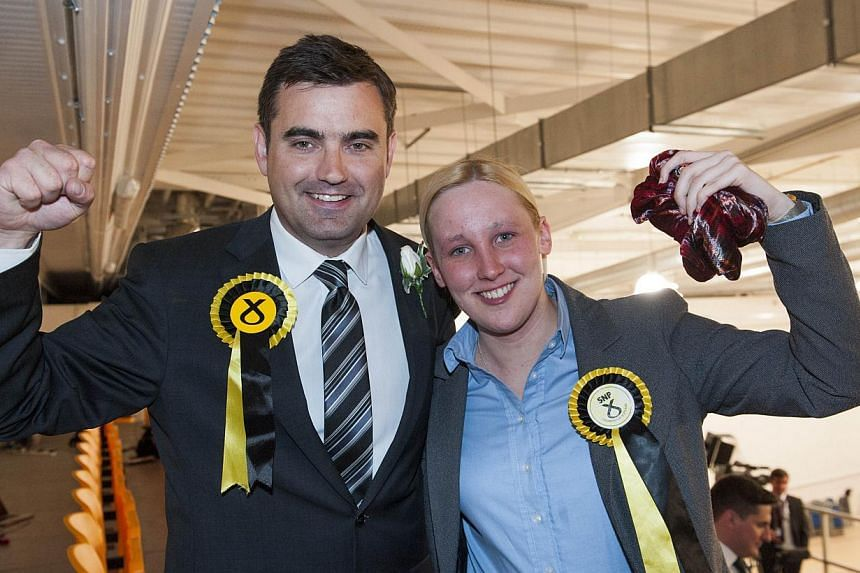 Scottish National Party (SNP) Member of Parliament Mhairi Black (right), Britain's youngest MP since 1667, with also newly elected SNP MP Gavin Newlands. -- PHOTO: AFP