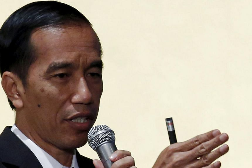 Indonesian President Joko Widodo speaking during the Indonesia business forum in Tokyo on March 24, 2015. Mr Widodo was expected to announce the release of several political prisoners in the restive eastern province of Papua on Saturday, seeking to r