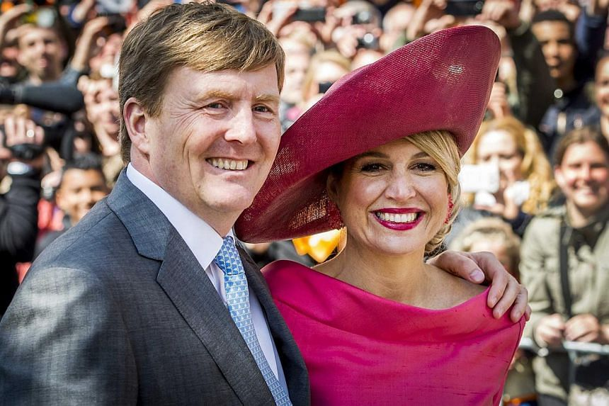 King Willem-Alexander and Queen Maxima of the Netherlands in Dordrecht on April 27, 2015, during King's Day, the celebration of the birthday of the King. -- PHOTO: EPA