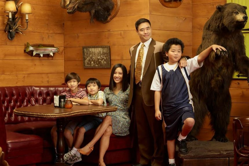 Randall Park (centre) stars as the father in Fresh Off The Boat, with his sitcom family (from left) Forrest Wheeler, Ian Chen, Constance Wu and Hudson Yang. -- PHOTO: FOX