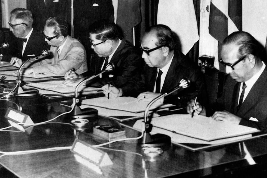 Mr S. Rajaratnam (right), then Singapore's Foreign Minister, at the historic 1967 Bangkok meeting, which saw the founding of Asean. With him are envoys (from left) Narciso Ramos from the Philippines, Adam Malik from Indonesia, Thanat Khoman from Thai