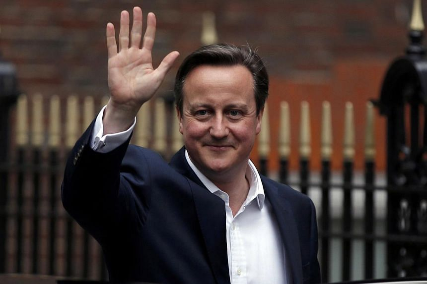 Britain's Prime Minister David Cameron waves as he leaves Conservative Party headquarters in London, Britain, on May 8, 2015. Britain was adjusting to a new political landscape on Saturday after a shock election victory for Prime Minister David Camer