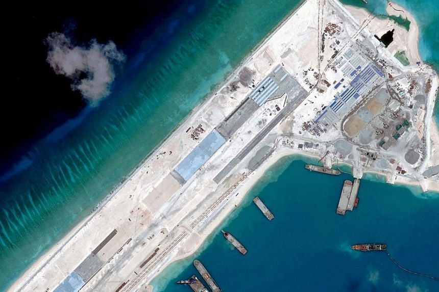 A satellite image from April 2015 showing China's construction of a runway on Fiery Cross Reef in the Spratly Island chain, estimated at 3.1km in total. -- PHOTO: REUTERS