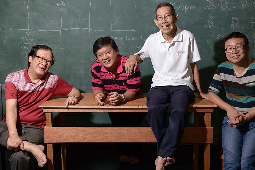 Crosstalk veterans Johnny Ng (second from left) and Yong Ser Pin (third from left) are cast members of It Could Have Been, a 120-minute crosstalk production written and directed by Han Lao Da (left) and Kok Heng Leun (right). -- ST PHOTO: DANIEL NEO