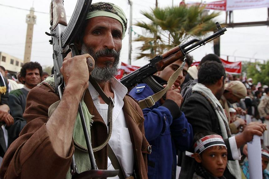 Supporters of the Shiite Huthi movement brandish their weapons during a demonstration against the Saudi-led air strikes, in the capital Sanaa, on May 8, 2015. Saudi Arabia's foreign minister announced a humanitarian ceasefire in the Yemen conflict to
