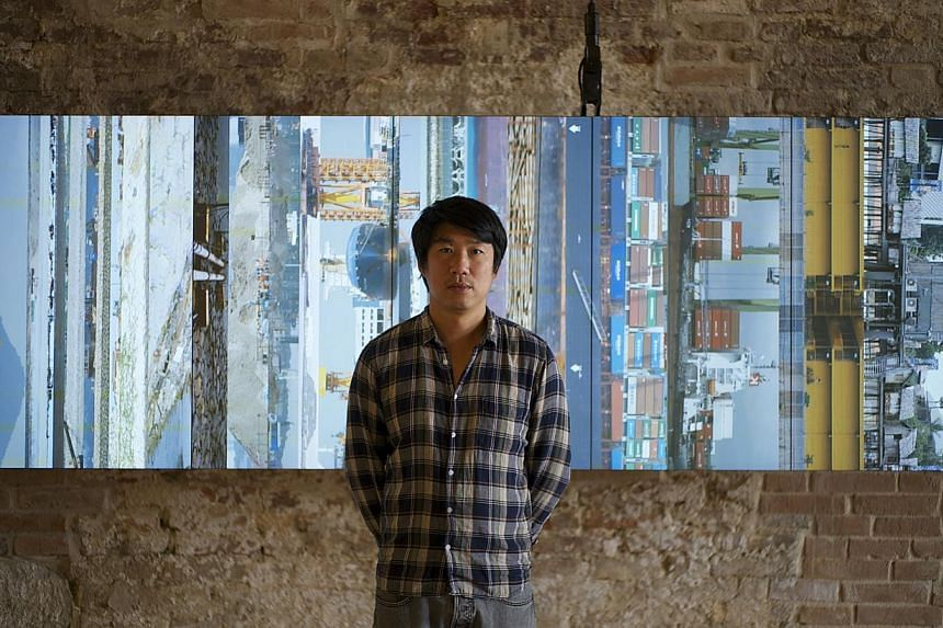 Artist Charles Lim and his installation Sea State at the Singapore Pavilion of the Venice Biennale 2015. -- ST PHOTO: WEE LI LIN