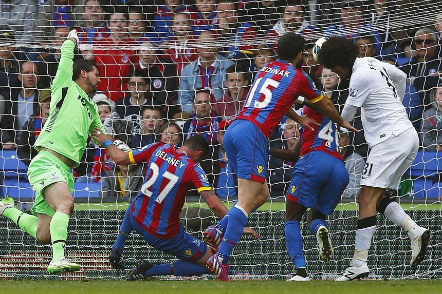 Manchester United's Marouane Fellaini scores their second goal against Crystal Palace on May 10, 2015. -- PHOTO: REUTERS