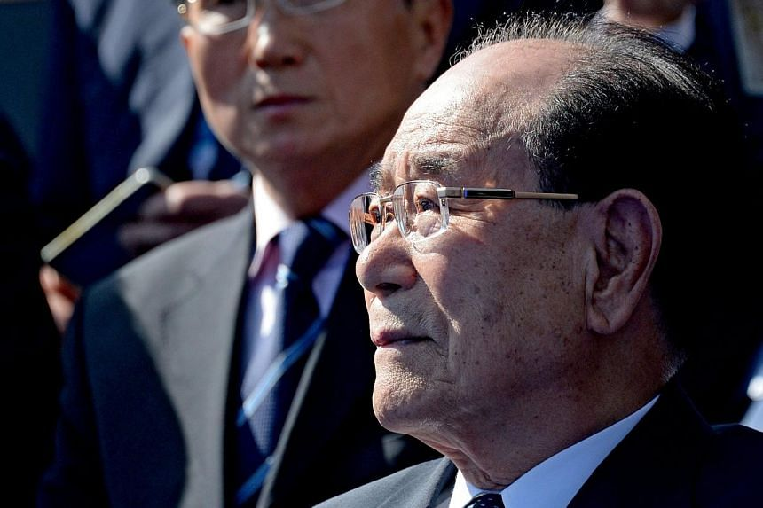 North Korean Chairman of the Presidium of the Supreme People's Assembly Kim Yong Nam (front) watches the Victory Day Parade in the Red Square in Moscow, Russia, on May 9, 2015. -- PHOTO: EPA