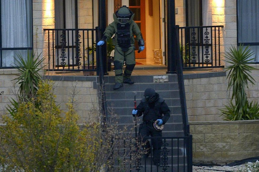 """Officers wearing bomb suits raid a home in Greenvale, Melbourne, Australia on May 8,2015. Australian police said on Sunday, May 10, that a teenager charged with a terrorist bomb plot was """"well advanced"""" in plans to target a public event, adding"""