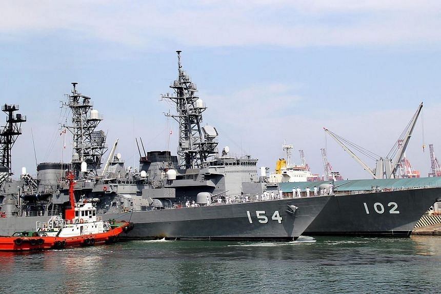 A handout picture released by the Philippine Navy Public Affairs Office shows the Japanese destroyers Harusame (back) and Amigiri (front) docking at Manila South harbour, Philippines on May 9,2015. The Philippines' navy chief said on Sunday, Ma