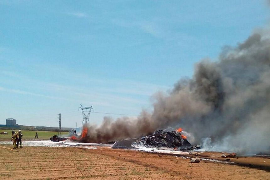 A handout picture released by the Spanish Police shows the wrekage of an Airbus A400 military plane which crashed in the San Pablo airport in Seville, southern Spain on May 9,2015. Spanish authorities on Sunday, May 10, found the two cockpit re