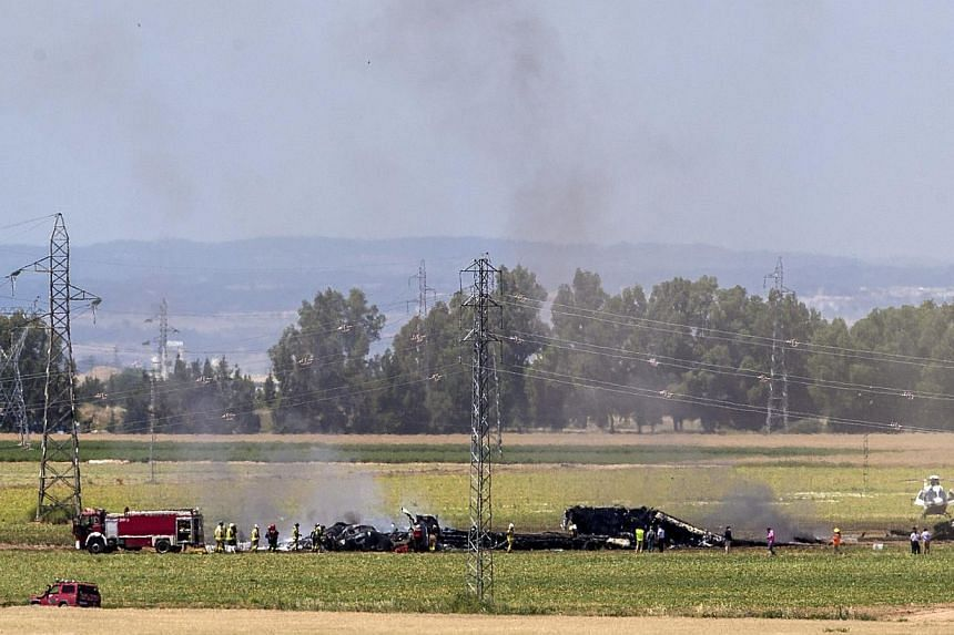 Smoke rises from the wreckage of an Airbus A400 which crashed in the San Pablo airport in Seville, southern Spain on May 9, 2015. Britain, Germany and Turkey said on Sunday, May 10, that they were temporarily grounding their Airbus A400M militar