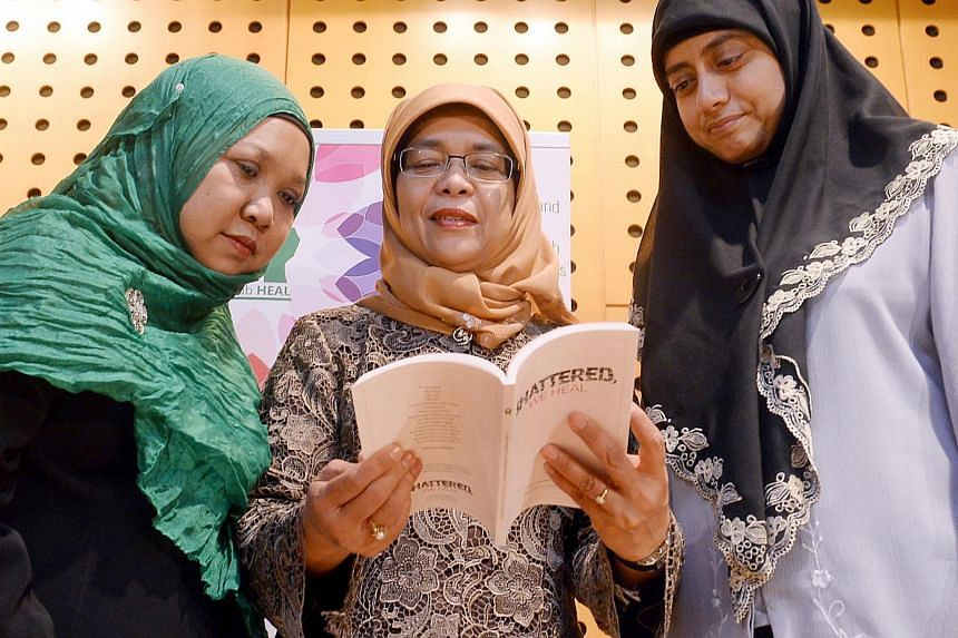 Speaker of Parliament Madam Halimah Yacob (centre) at the launch last year of the book Shattered, We HEAL, written by Madam Yohanna Abdullah (left) and Dr Radiah (right).