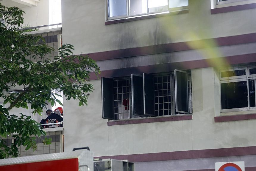 Scorch marks can be seen outside the window of the flat that caught fire in Tampines on Sunday night. -- ST PHOTO: CHEW SENG KIM