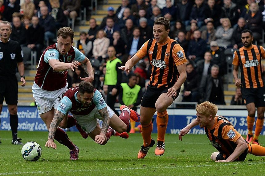 Burnley's English striker Danny Ings (third right) is brought down in the peanlty area by Hull City's Irish defender Paul McShane on May 9, 2015. Burnley were relegated from the Premier League on Saturday despite winning 1-0 at fellow strugglers Hull