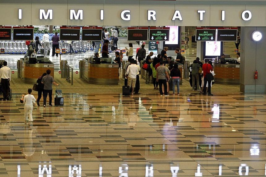 Inbound passengers from Doha arriving at the immigration counters in Changi Airport Terminal 3 on May 18, 2014. -- PHOTO: ST FILE