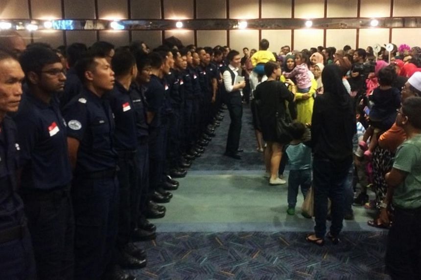 Family members welcome back 126 Home Team officers at Changi Airport Terminal 2 on Saturday. Some 126 Home Team officers returned home on Saturday evening to a rousing welcome after spending two weeks carrying out rescue operations in earthquake-hit